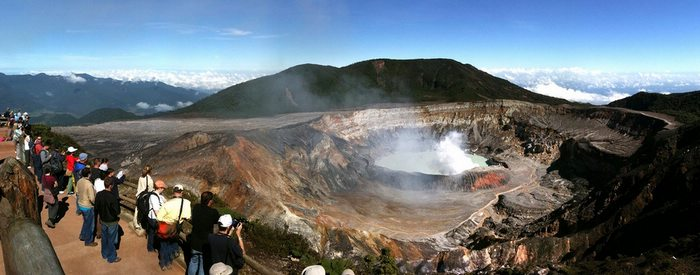At the crater of the Poás Volcano, sulfuric furmaroles burst upwards, ruffling the calm surface of the ethereal lake. Photo by Sandra Cohen-Rose & Colin Rose/Flickr