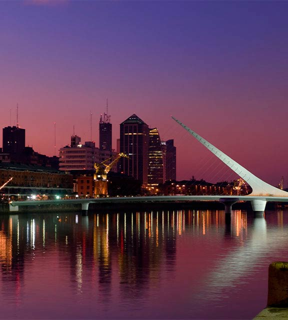 Night falling over the Puente de la Mujer bridge in the Puerto Madero district of Buenos Aires.