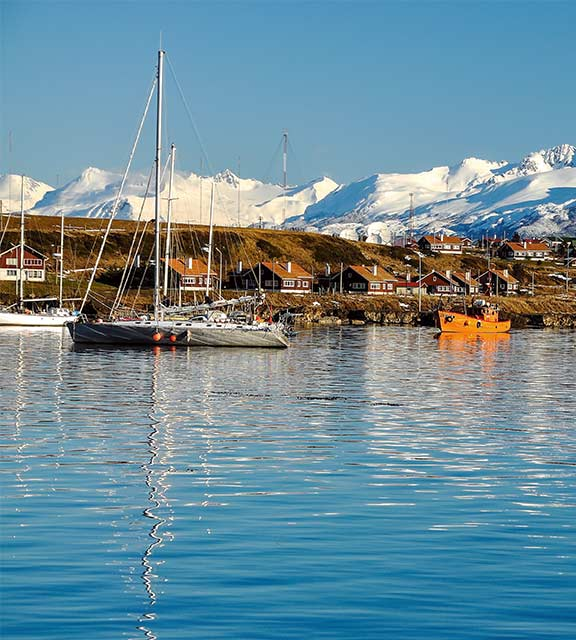 Snow-covered mountains overlooking the port of Ushuaia, the southernmost city in the world.