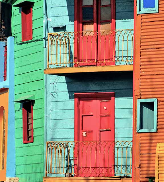 Colorful painted buildings in the traditional alley known as Caminito in Buenos Aires.