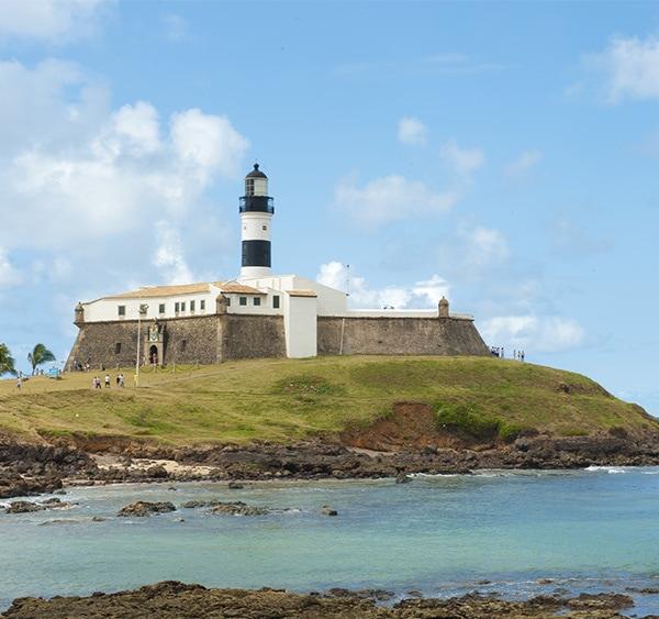 Farrol da Barra, a historic lighthouse dating to the 17th century located in Salvador de Bahia.