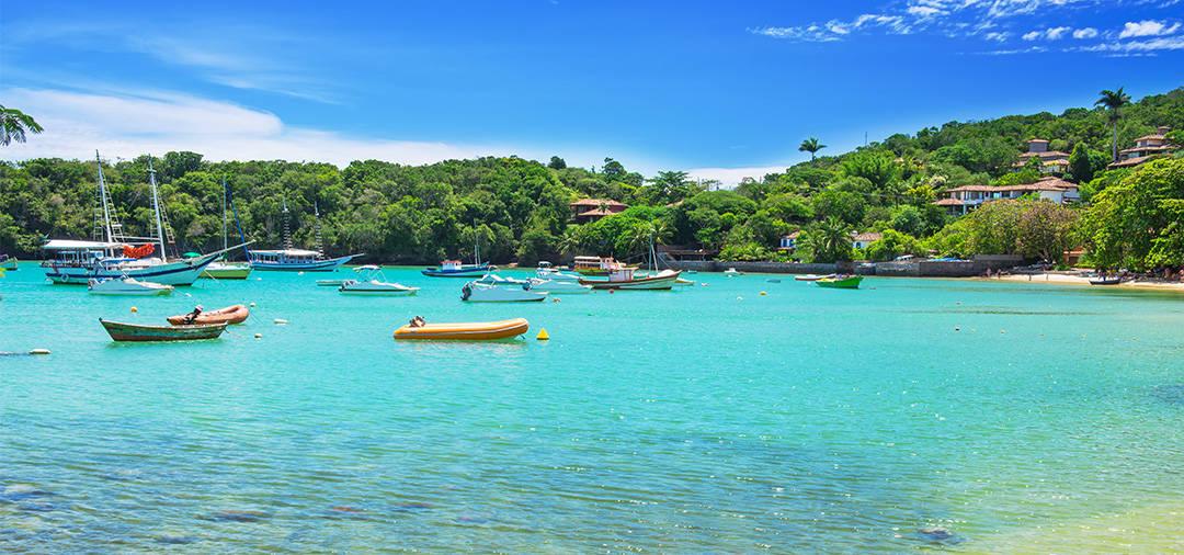 TBoats in the water off the shore of Buzios, a popular beach resort town near Rio de Janeiro.