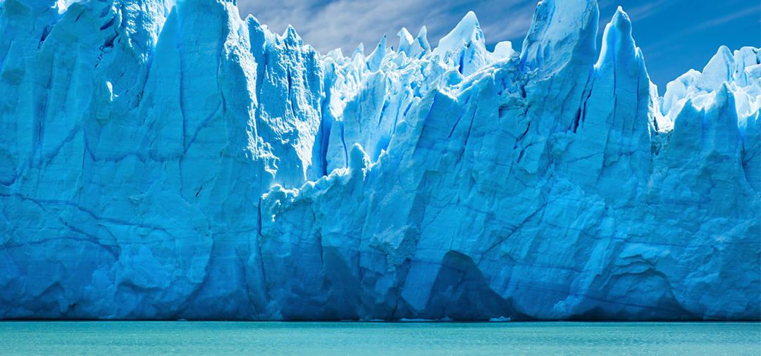 Jagged spires of a  blue-tinted glacier in Los Glaciares National Park in Argentina.
