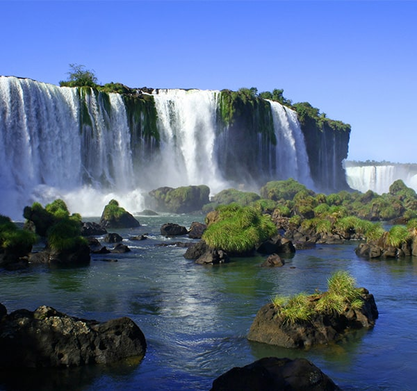 Moss-covered rocks and a waterfall in one section of Iguazu Falls in Argentina.