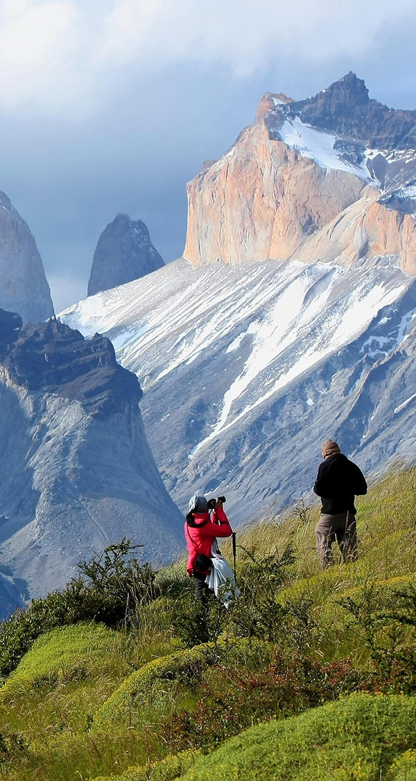 A couple of hikers stopping for a photo on the trek to Torres del Paine in Chilean Patagonia.