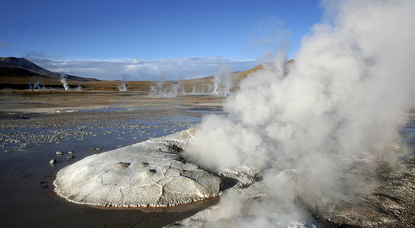 Multiple geysers emitting steam in the Tatio Geyser field of the Atacama Desert.