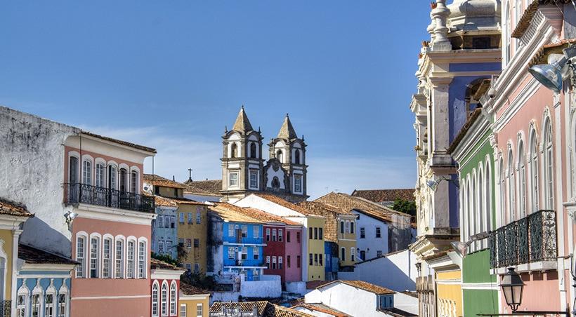 Historic buildings of Salvador de Bahia, beautifully painted in various pastel colors.