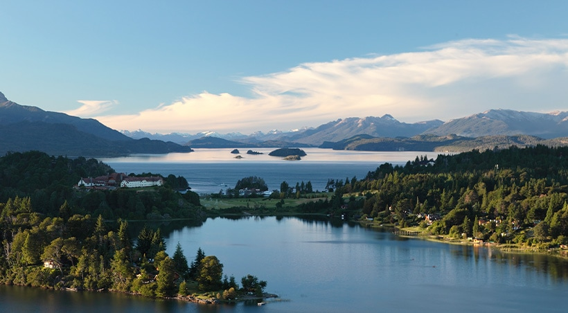 Scenic lake surrounded by forests and mountains in the countryside near the town of Bariloche.