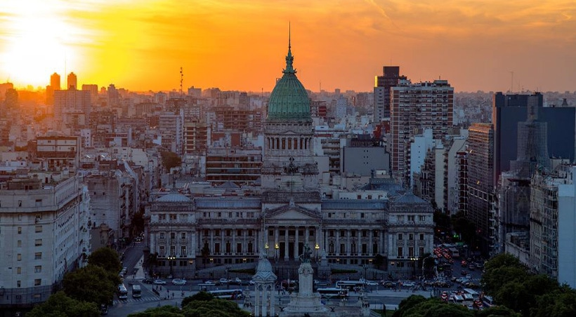 Sun setting over the Palace of the Argentine National Congress and the Buenos Aires skyline.