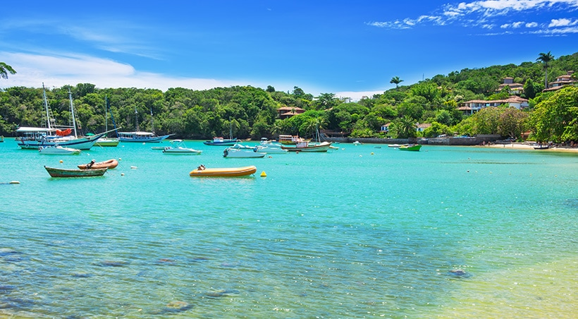 Boats in the water off the shore of Buzios, a popular beach resort town near Rio de Janeiro.
