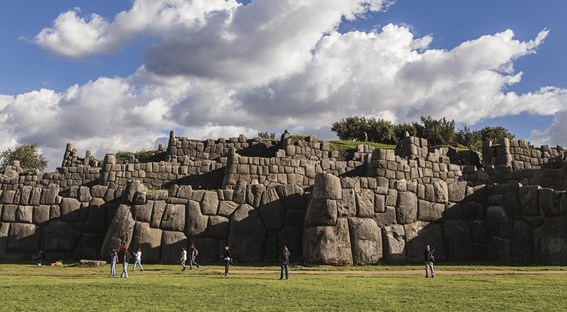 Massive stone walls at the ruins of Sacsayhuamán, an Inca fortress overlooking the city of Cusco.