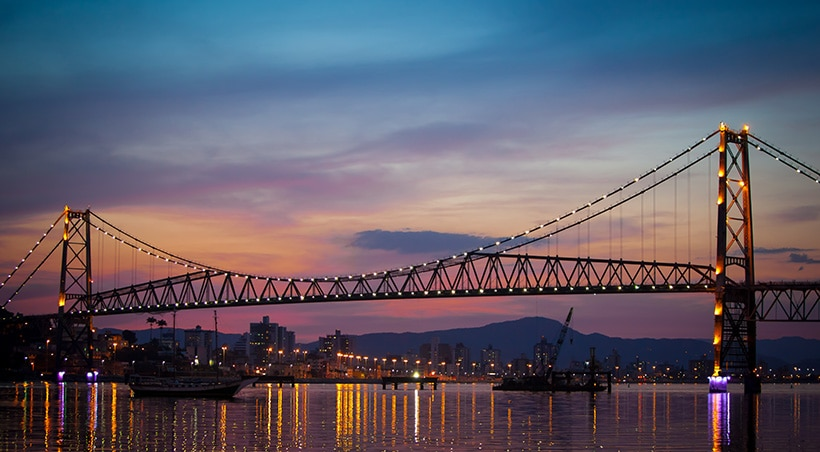 Sunset over Hercílio Luz bridge, linking Santa Catarina Island to the Brazilian mainland.