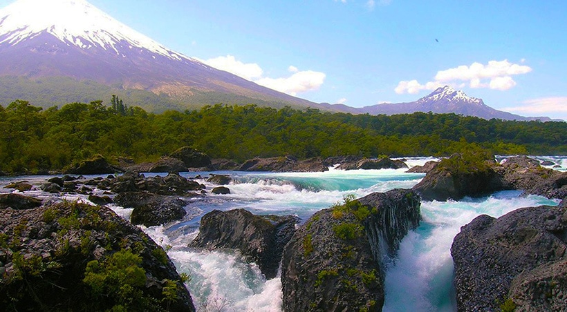 Petrohue Falls overlooked by the majestic Osorno Volcano in Vicente Pérez Rosales National Park.