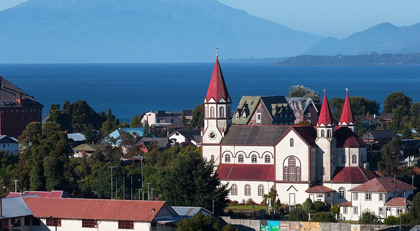 A traditional church towers over the town of Puerto Varas on the shores of Lake Llanquihue.