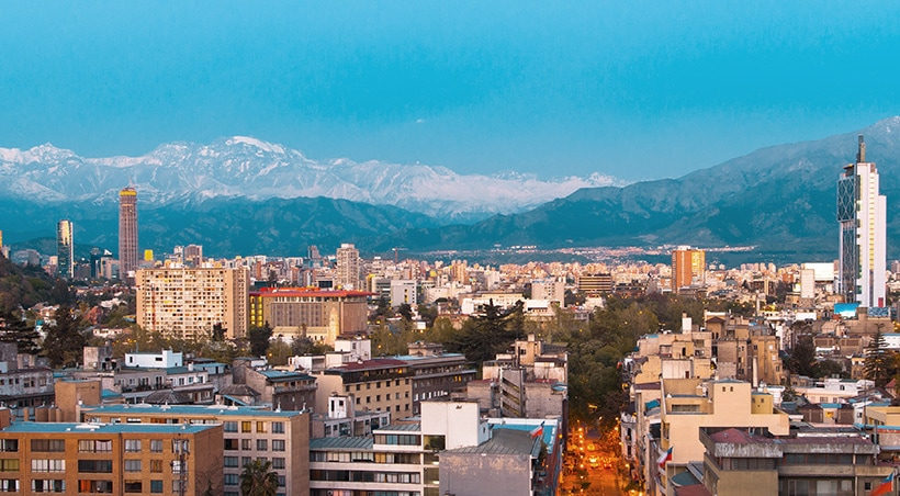 View of the city of Santiago, with the snow-capped Andes Mountains towering overhead.