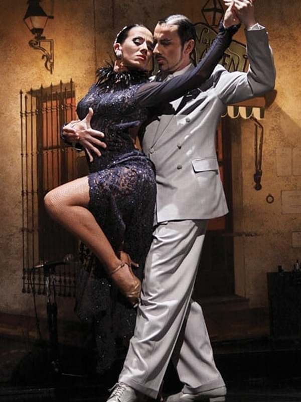 A couple dancing the tango, a typical dance of Buenos Aires and part of its cultural heritage.