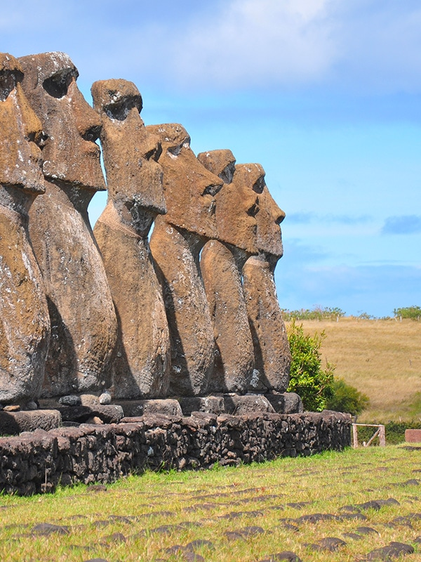 A row of moais, the human figures made of stone left by the inhabitants of Easter Island.