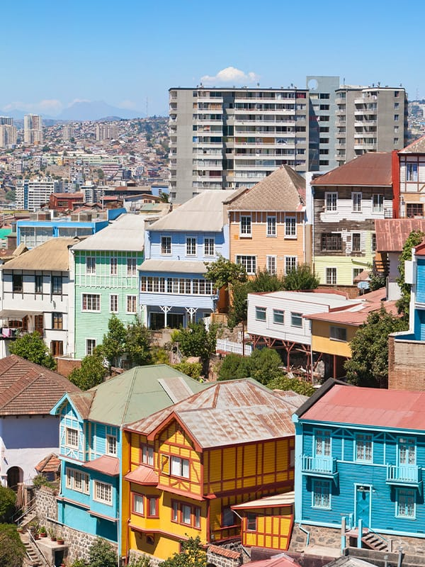 Colorful traditional houses and modern buildings in the Chilean port of Valparaíso.